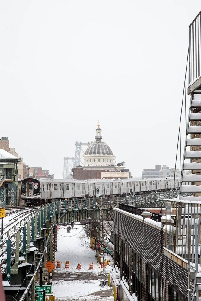 Williamsburg, Brooklyn --- elevated subway train against backdrop of former Williamburgh Savings Bank [domed building] and the Williamsburg Bridge.