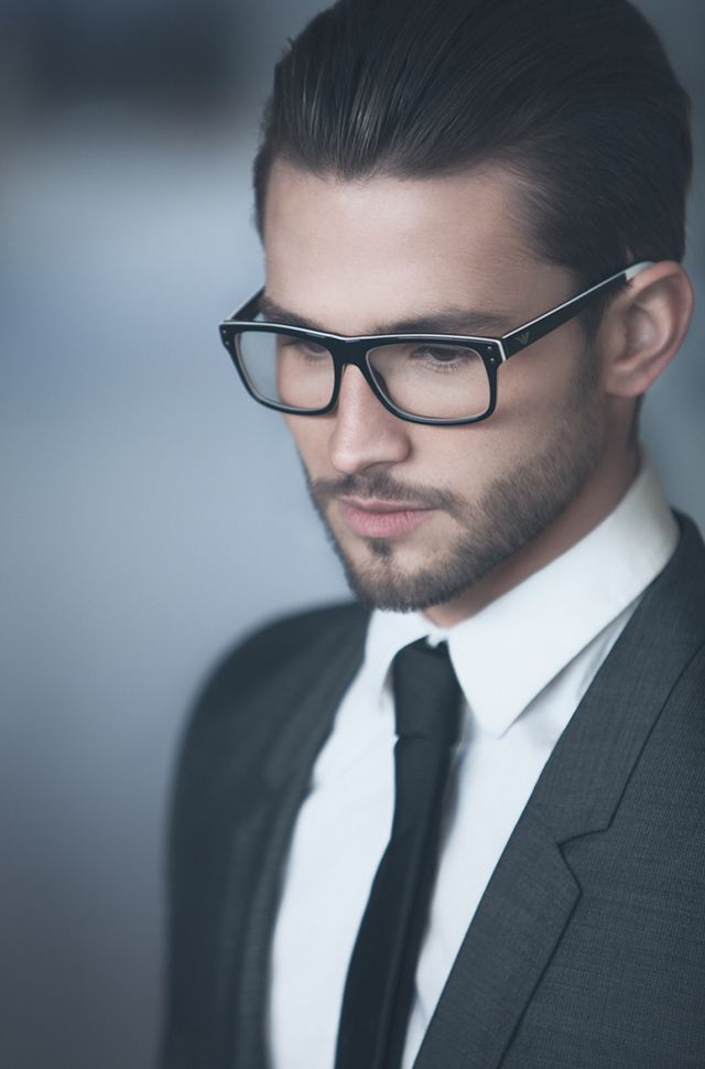 I love the complete look - his suit, shirt, tie, glasses, his hair and beard. Awesome!!