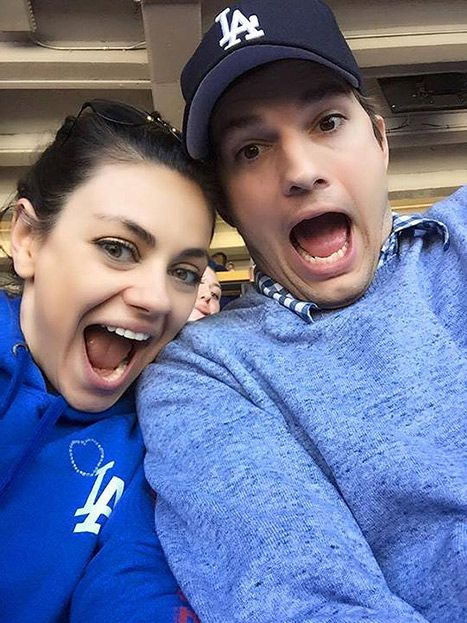 Mila Kunis and Ashton Kutcher goofed off on opening day at the L.A. Dodgers game on April 6.