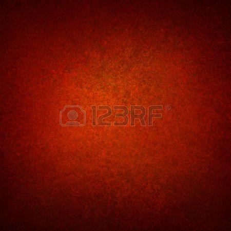 rijke rode oranje achtergrond muur met zwarte vignet grens en licht centrum abstract gedetailleerde  Stockfoto