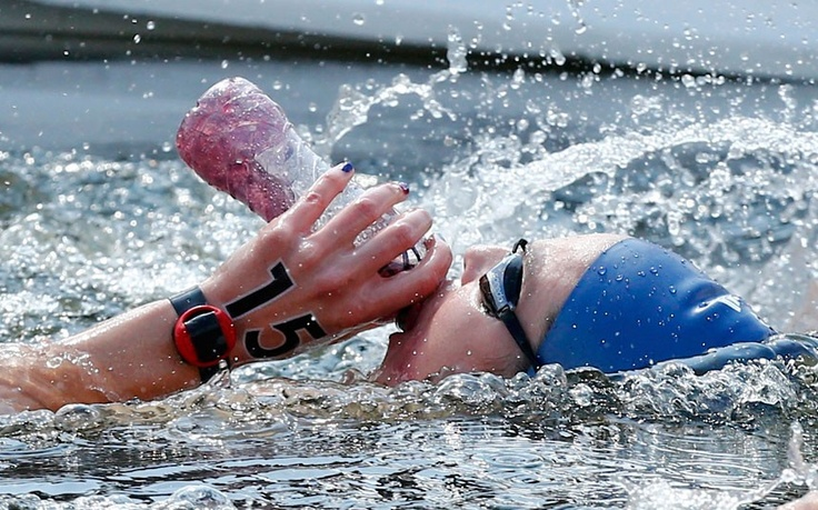 Keri-anne Payne takes a drink as she competes in the women's 10km marathon in Hyde Park