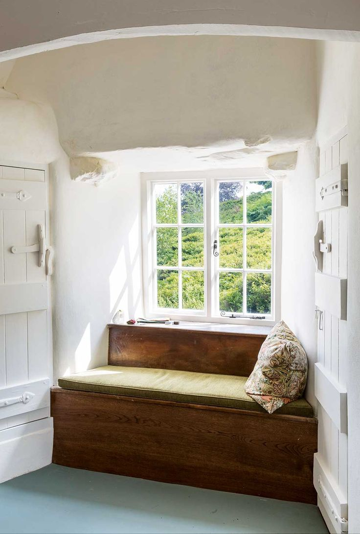 It is  possible to step out straight onto the bank from this bedroom window.. Window seat at Stoneywell Cottage by National Trust