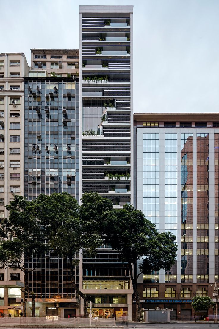 Triptyque has revamped a 85-metre-high office block in Rio de Janeiro with zigzagging glazing and solar panels so it can generate its own electricity