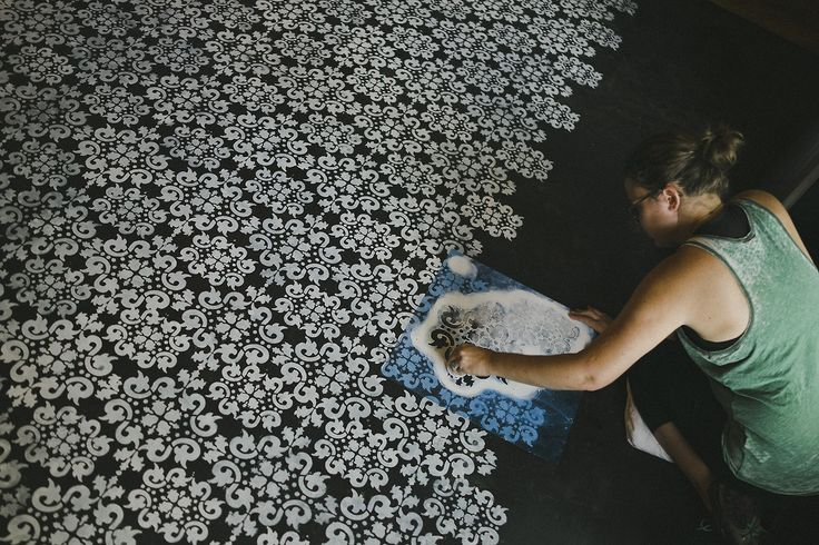 Painted concrete floor with stencils. so much work. but wow how beautiful.