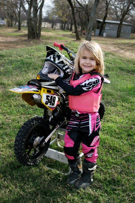 A lil moto princess. Adorable and so proud of her dirt bike!