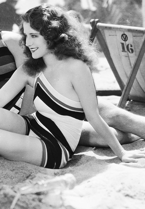 1920s beach wear (Norma Shearer) vintage fashion style color photo print ad model magazine 20s deco one piece bathing suit swimsuit sportswear chevron stripes