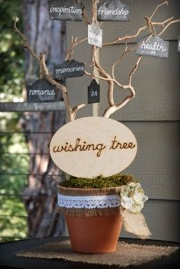 "8.09 SALE PRICE! This rustic sign is a unique addition to your wedding reception decor. The ""wishing tree"" wood sign features handwritten wood-burn..."