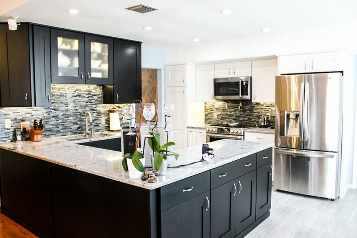 the contrast of the white countertop with the black cabinetry is very sharp the backsplash is a great accent for the kitchen bridgewood - White Countertops