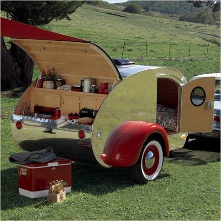 """Teardrop Trailers are the """"bomb"""".  Could you imagine camping near a stream bed, fishing for trout then cooking it on your little camp stove?  And come night time, you'll be snug as a bug in a rug in the camper - doors open or closed."""