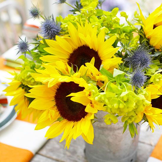 Arrange colorful flowers in a galvanized pail. More centerpiece ideas: http://www.bhg.com/party/birthday/themes/pretty-outdoor-centerpieces-and-table-accents/?socsrc=bhgpin0530127