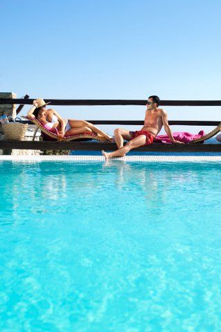 Relaxing by the poolside at the Apollonia Mykonos Resort, Greece http://www.mediteranique.com/hotels-greece/mykonos/apollonia-resort/