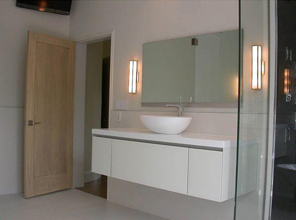 modern lighting bathroom. greta adds a warm flattering glow to this modern bathroom lighting