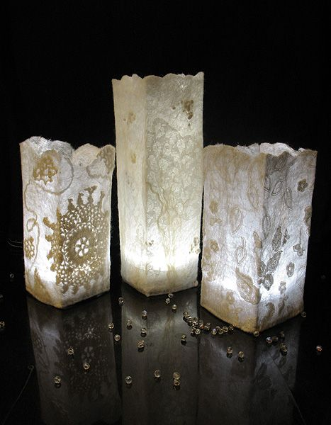 frosted lamps made by wet felting wool, and silk with lace and doilies.  (tutorial in russian ,but, the series of photos are self explanatory)