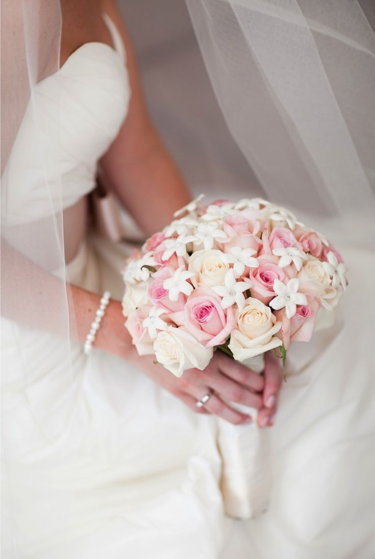 Pink bouquet Roses & stephanotis with gems on the inside. Satin ribbon detail