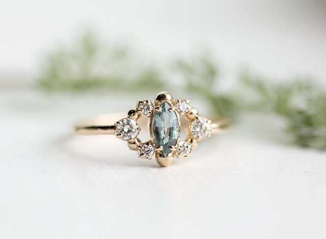 So in love with the mossy sapphire in this custom marquise cluster ring (melanie casey jewellery)