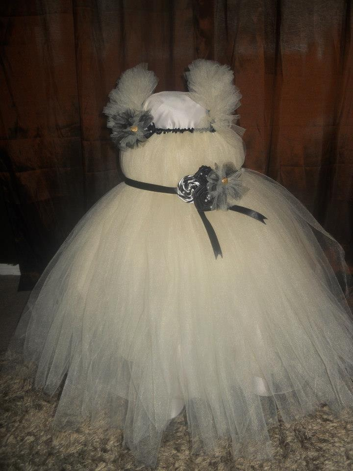 Handmade by Candy's Creations    Little Princess Tutu Gown - Average size 3-4 years.    Ivory Gown with Ruffled Sleeves. Trimmed with Black Satin. Black Tie Back Sash, Adorned with Handmade Black Satin Flowers, Ivory and Black Tulle Puff, Ivory and Black Satin Lollipop Twist and Pearls. Right Shoulder Strap is Adorned with a Black and Ivory Tulle Puff and a Black Satin Flower with Pearls.    Price: $65  Shipping: Send message    Like us on Facebook!    www.facebook.com/CandysCoutureCanada