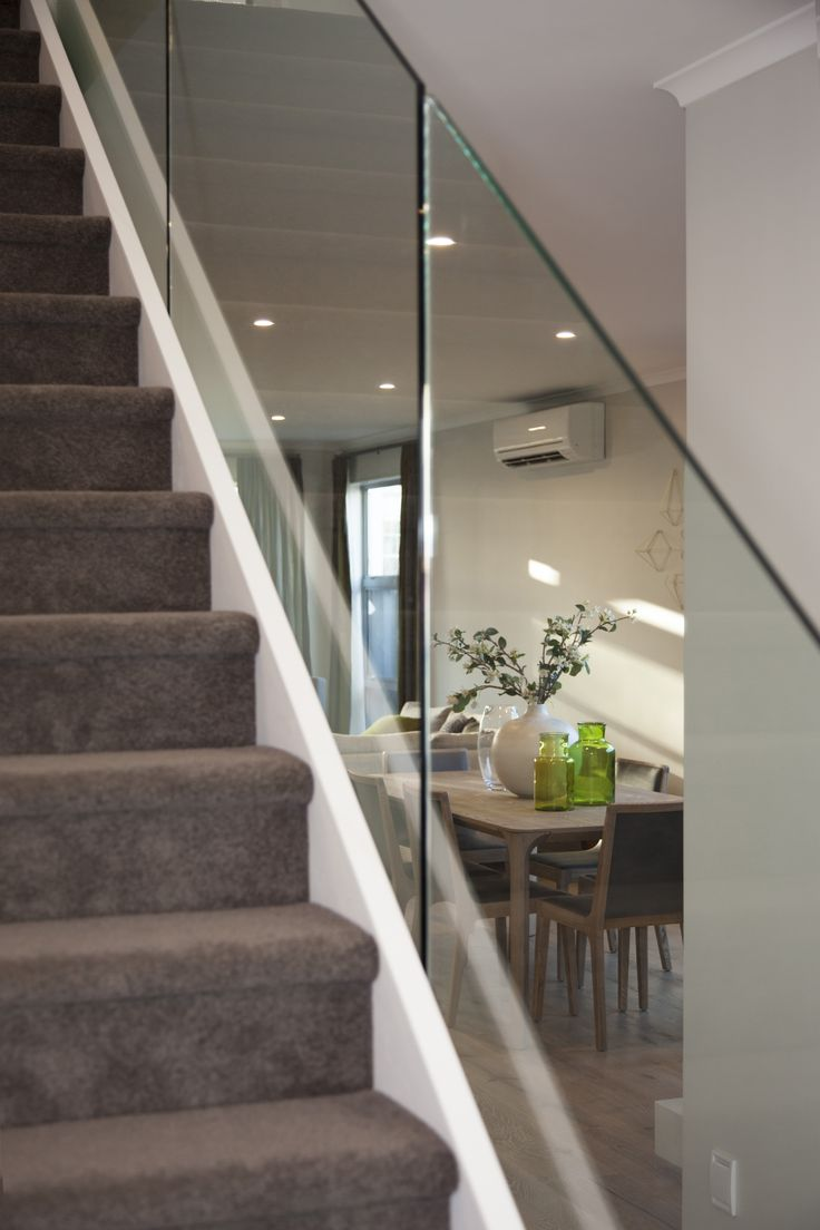 Using glass on this staircase creates a more modern and open feeling to this G.J.Gardner home.