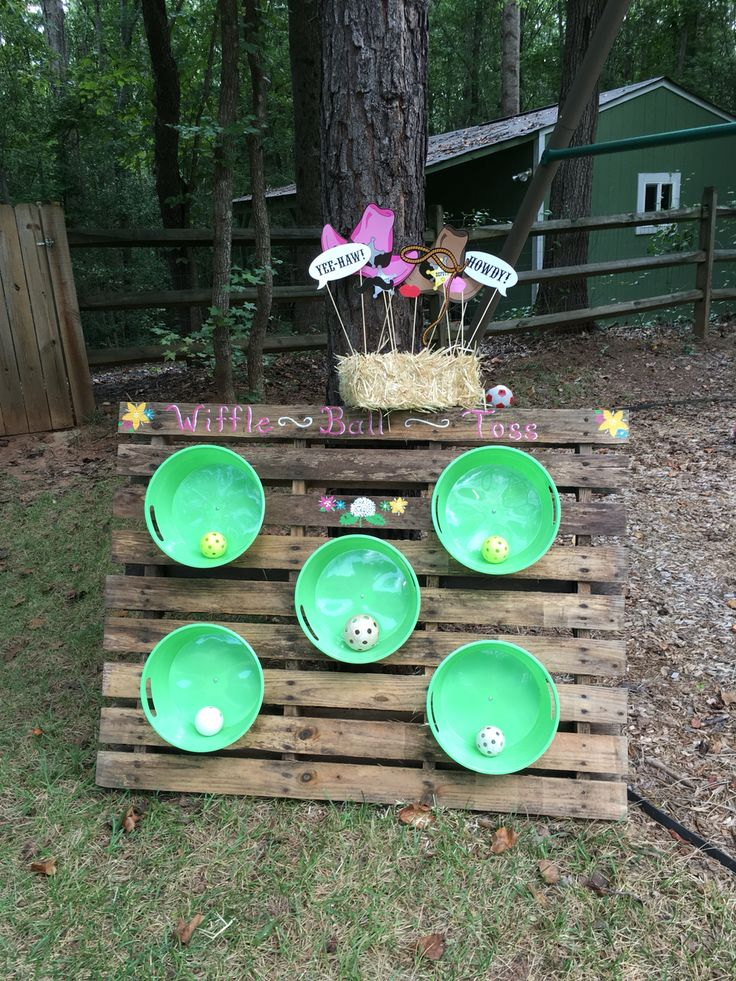wiffle ball toss game using plastic buckets screwed into an old pallet