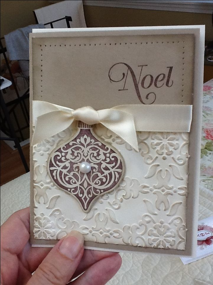 Beautiful Handmade Christmas Card rub ink over an embossed surface with a sponge to give dimension
