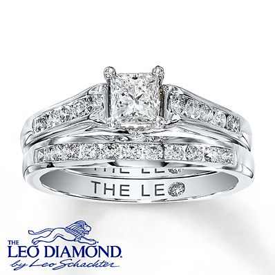 A breathtaking princess-cut Leo Diamond is the centerpiece of this beautiful engagement ring for her. The center diamond is laser-inscribed with a unique Gemscribe® serial number and is independently certified. Channel-set Leo round diamonds lend additional sparkle to the 14K white gold band. The matching wedding band features a row of round Leo diamonds to complement. The total diamond weight of this amazing bridal set is 1 carat.