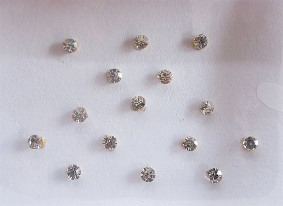 16 Sparkly Silver Stick On Fake Nose Studs With by Beauteshoppe