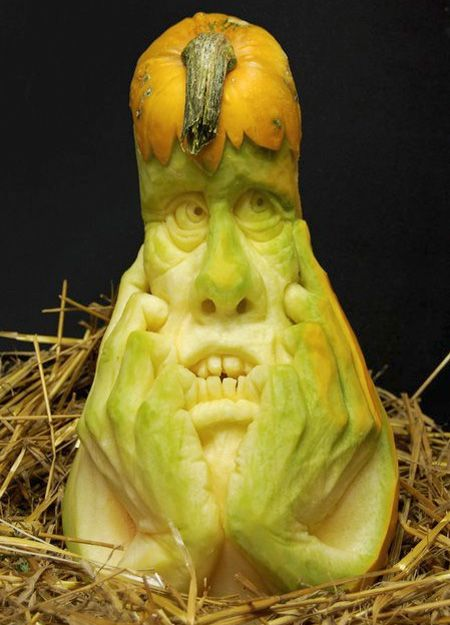 Long gourde carved into a face and hands