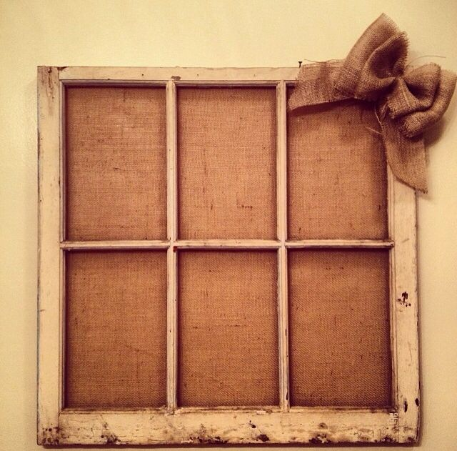 Old window pane with burlap background. put black and white pictures. also hot glue clothes pins and hang the pictures from that.