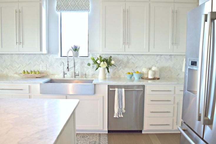 white kitchen farmhouse stainless sink commercial faucet shaker doors carrara marble.  love this kitchen!!
