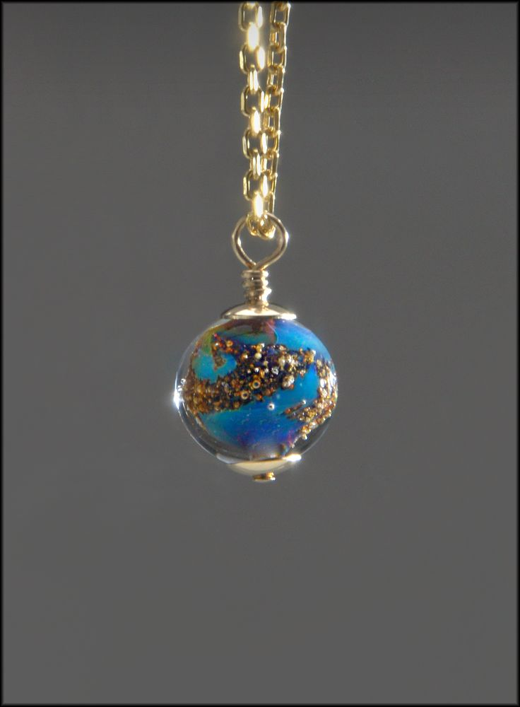 A beautiful small memorial bead made with the ashes of your loved one.