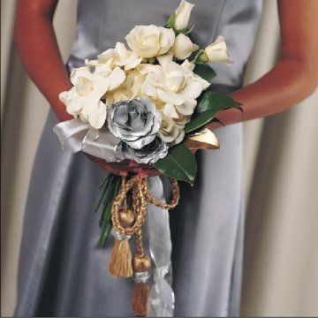 Winter Wedding Flowers - This is a great way to carry the cord if you are doing a Handfastening Ceremony.