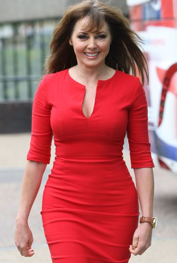 Manly Fall Wallpaper Lady In Red Carol Vorderman Shows Off Her Hourglass Body
