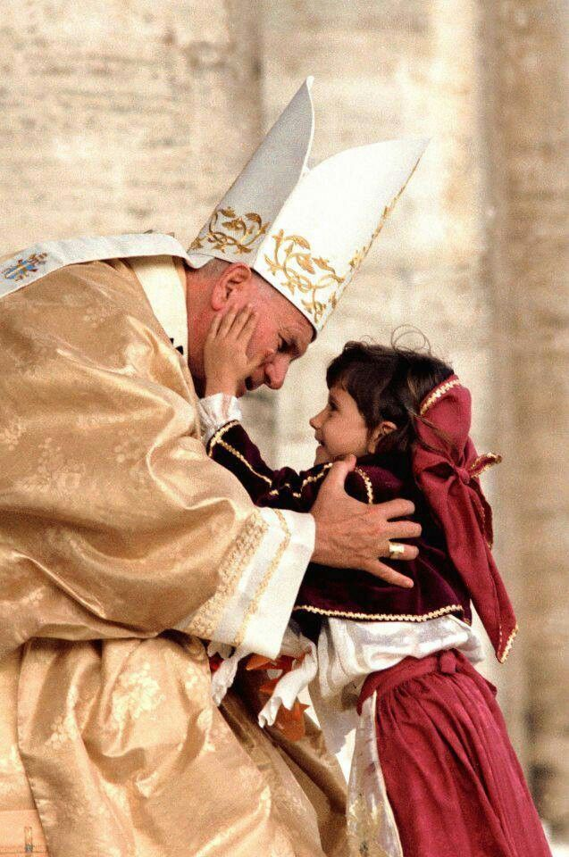 John Paul II- his canonization is LIVE on EWTN right now (2:48 am Central). Turn it on!
