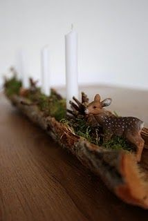 deer in a moss filled trough, with candles - I absolutely LOVE this! It would look so pretty on my table in this little cabin.