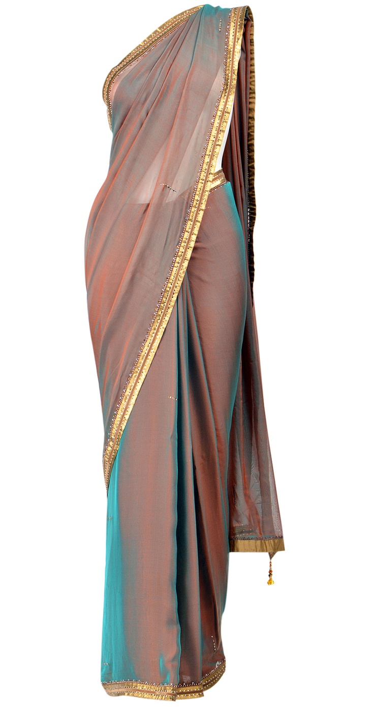 Simple, stylish and chic! Tarun Tahiliani gives us transcendent traditional wear with this shaded silk chiffon sari. It comes with a V-neck blouse with crystal work and a matching petticoat. As the calendar strikes October, this beautiful sari will vanish so get it NOW at www.perniaspopupshop.com