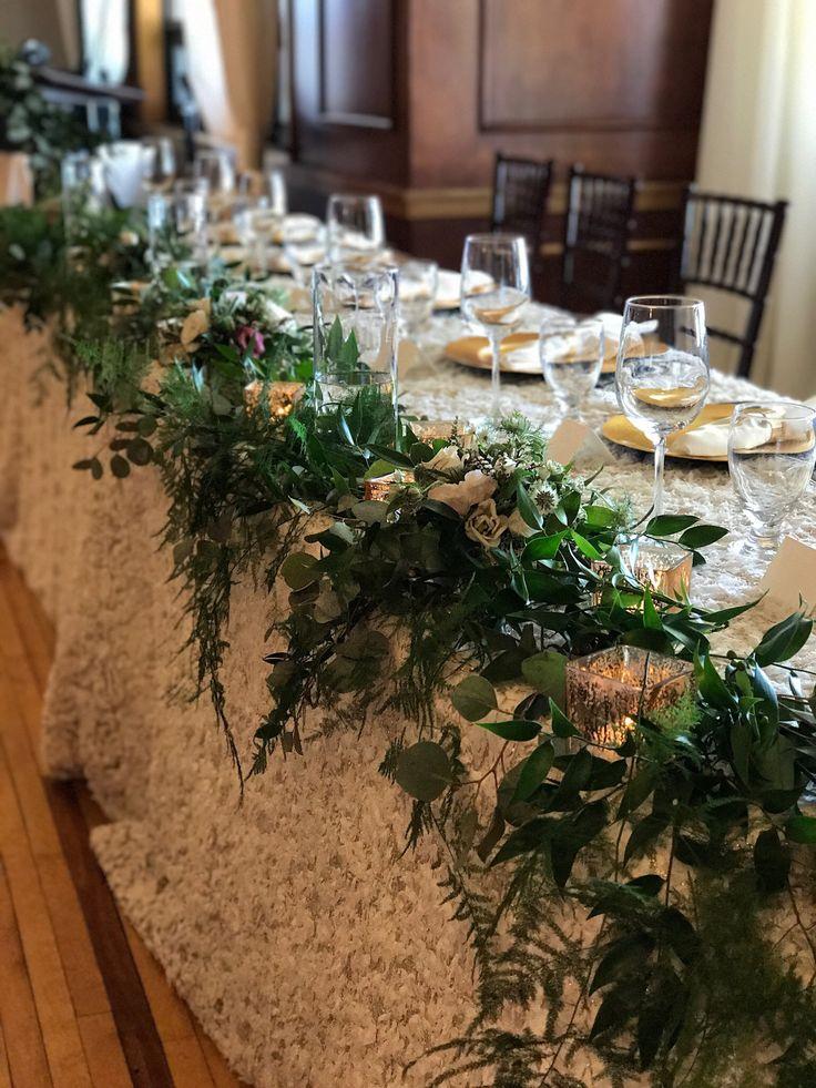 Head table flow    #weddings #wedding #headtable #garlabd #organic #white #canada #ontario #floralart #weddingflowers #flowers #floraldesign #greens #handplacedgarland #rustic
