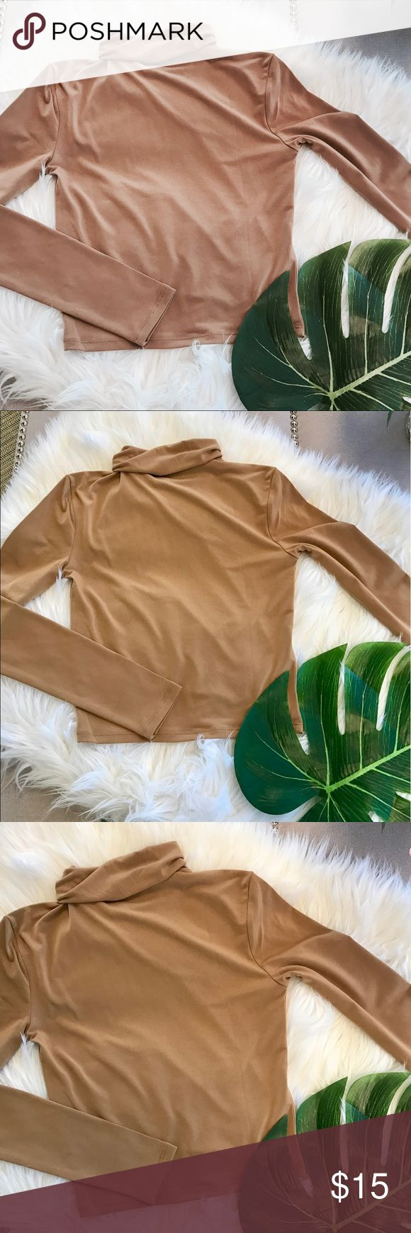 Forever 21 Camel Crop Turtleneck Top Camel colored crop top. Turtleneck & long sleeved. Super soft! Perfect for Fall & Winter. Paired perfectly with a leather skirt or high waisted black pants and booties! Also great for layering with overalls, slip dresses, etc. Has never been worn! Forever 21 Tops Crop Tops