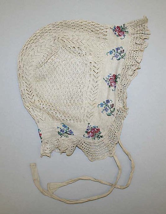 antique knitted baby bonnet with beads included in the stitches ... c. 1850