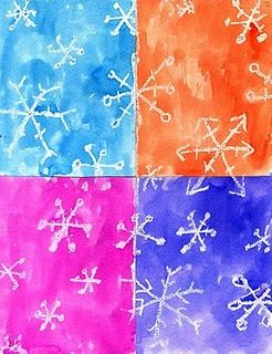 Snowflake Art using white crayon and water colors.