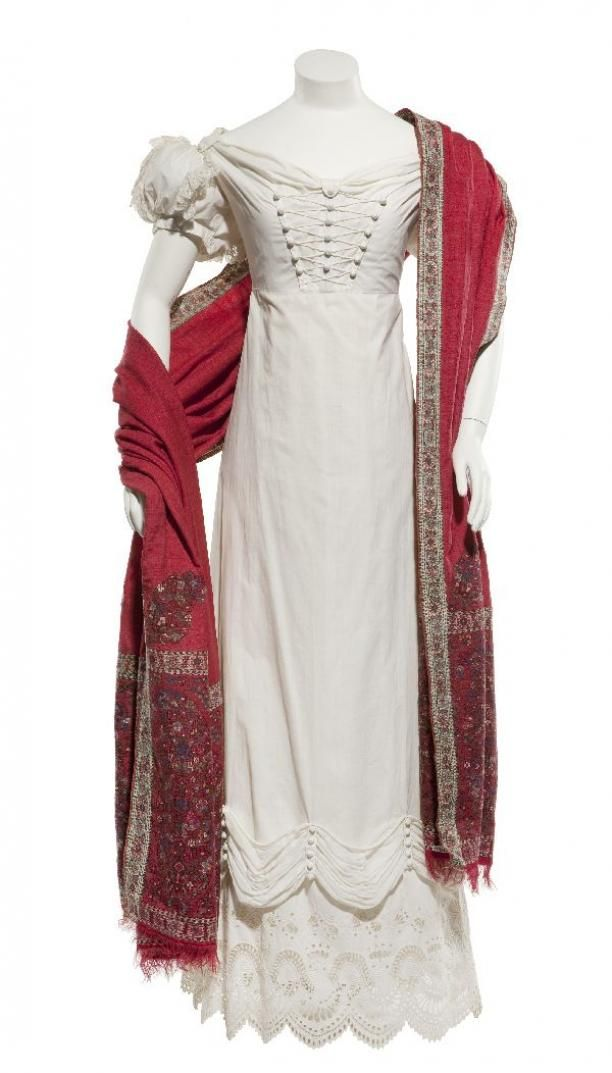 Dress of white cotton, topped with bouillonnées of white batiste, along the lower edge a scalloped edge of English embroidery...circa 1820-1822