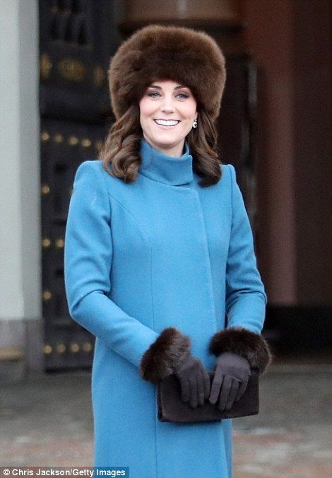 Kate, 36, looked elegant in her oversized fur hat and appeared to have swapped her Cornelia James gloves for a new pair with fluffy cuffs to match her headgear