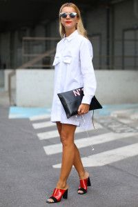 White man's shirt as a shirt dress with black clutch and sandals with high heel. Learn the 7 unique ways how to wear man's shirt >>> http://justbestylish.com/7-unique-ways-how-to-wear-mans-shirt/