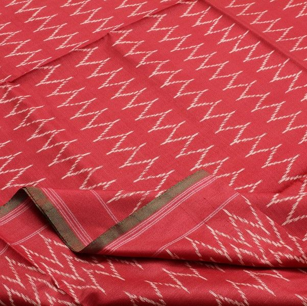 Zig zag motifs woven in #Ikkat lend this #sari a smart and classic look. A warm hue of tomato red is seen in the body while zigzag waves in white embellish the sari, quite striking in contrast against the red. The waves draw closer near the border, imparting a lovely proportion of design. The border is simply lined and then finished with an edge of green warp interwoven with the red weft. Code 060511018.