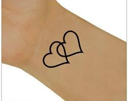 Image result for two hearts tattoo                                                                                                                                                                                 More