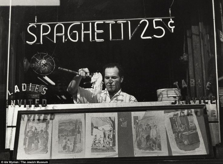 Serving up a treat: This Italian restaurant - in 1945 - was near the offices of Acme Newspictures, where photographer Ida Wyman became their first female photo printer