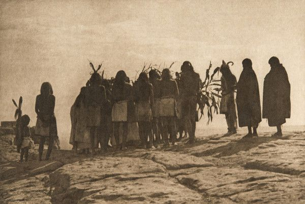 Flute dancers returning to Walpi (The North American Indian, v. XII. Norwood, MA, The Plimpton Press, 1922) by Edward Sheriff Curtis from USC Libraries