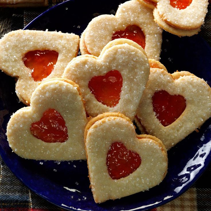 Sweetheart Coconut Cookies Recipe -Ruby red jam and coarse sugar add a festive look to these crisp sandwich cookies that are the perfect gift for loved ones. My husband likes coconut, so I make these for his birthday. —Jo Ellen Helmlinger, Columbus, Ohio