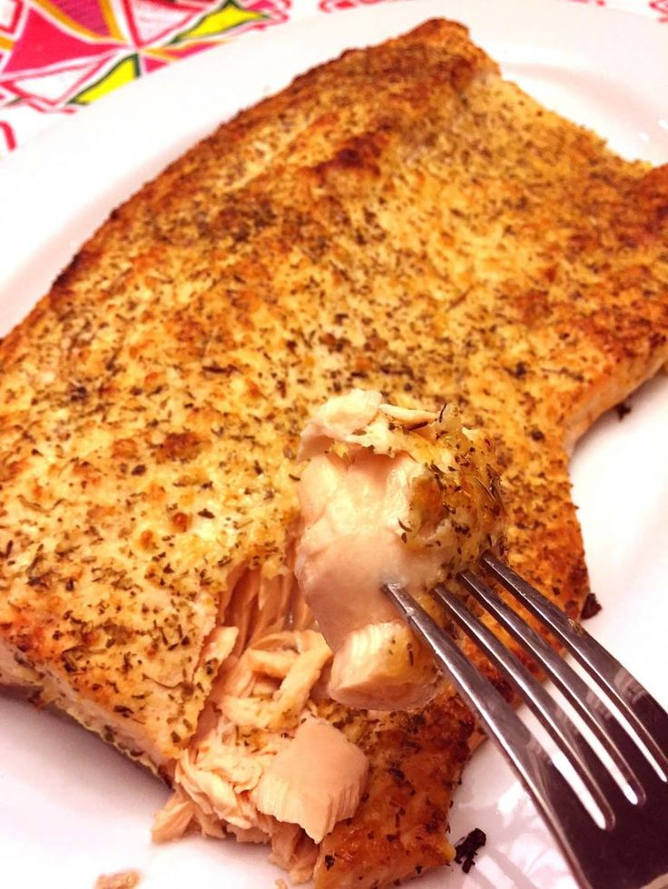 This gorgeous Parmesan crusted salmon is the king fish!  Baked to perfection under the golden crust of Parmesan cheese and herbs - so succulent on the inside, this is the tastiest salmon recipe ever! When you take this salmon out of the oven, you will whisper OMG! This giant fish is so beautiful, you won't believe it just came out of your kitchen!  Golden brown Parmesan crust, with aromatic herbs throughout - biting into it is as good as it sounds.  Break through the Parmesan crust and ge...