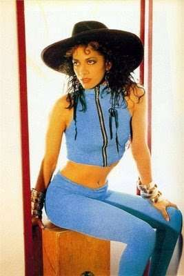 Sheila E. in a Crop Body Fitting Outfit