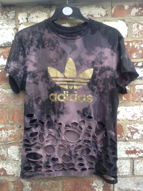 Distressed bleached and slashed vintage adidas t shirt with gold trefoil. Upcycled and reworked from authentic Adidas Originals tee for a grunge effect.
