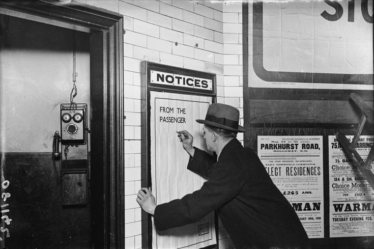 A man writing on a complaints poster, 1922. | 38 Breathtaking Pictures From The Early Days Of The London Underground.....